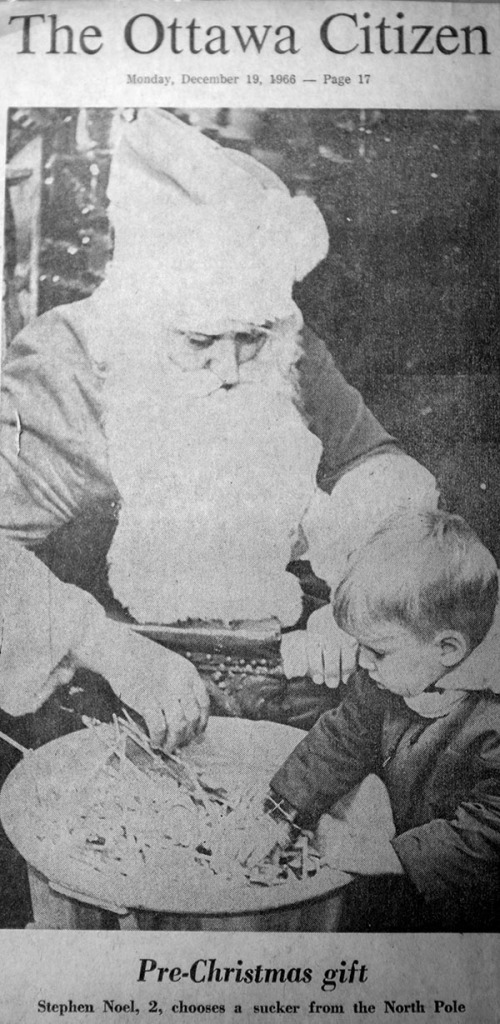 Photo from the Ottawa Citizen showing me taking candy from Santa Clause.